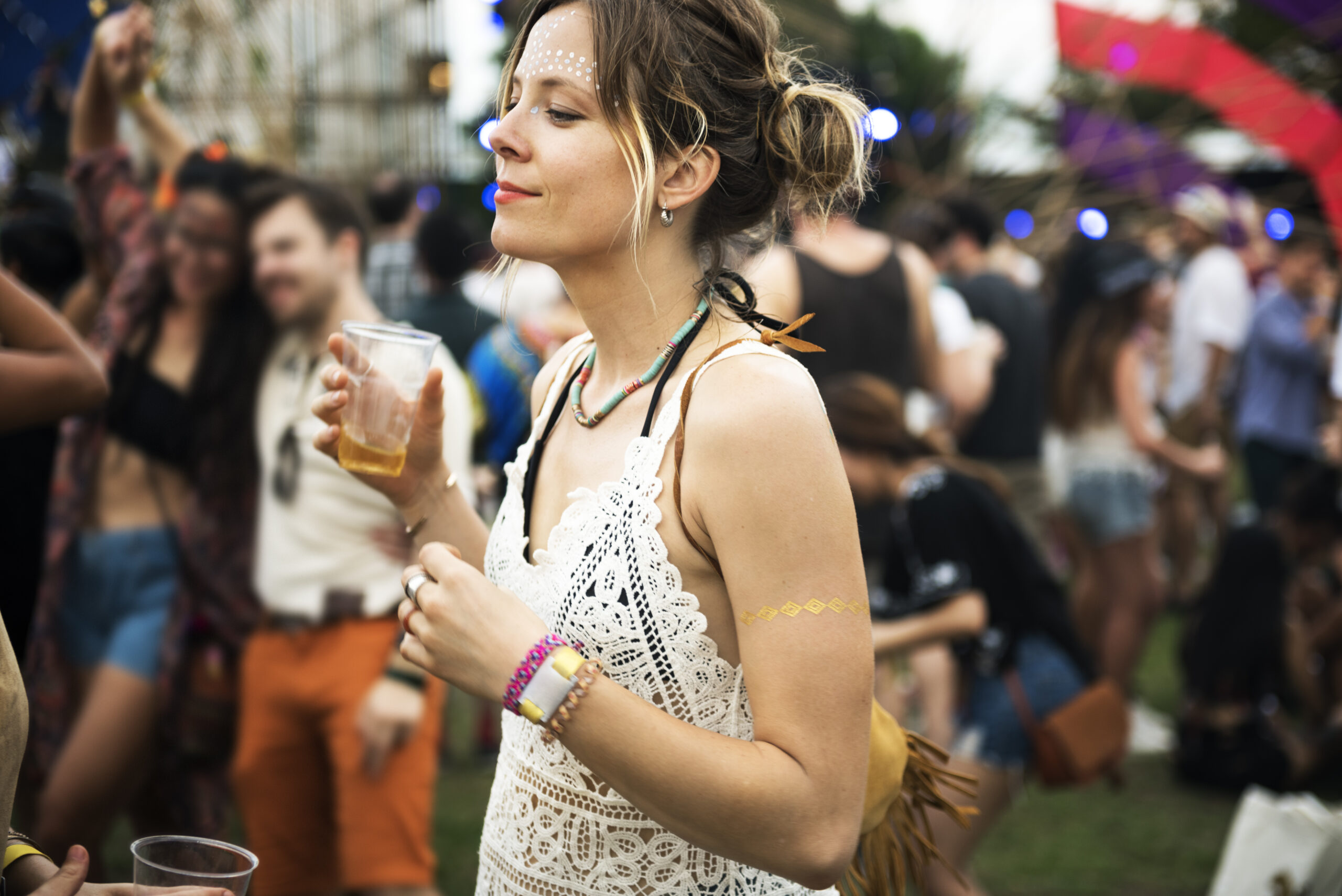 Woman with Beers Enjoying Music Festival