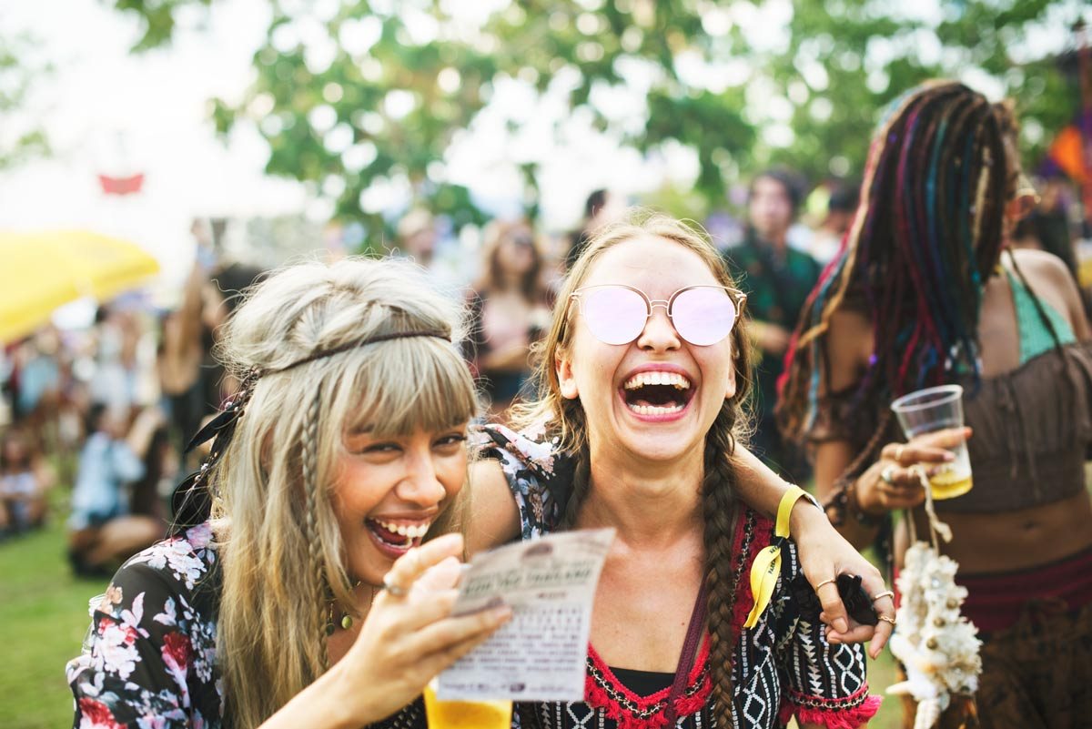 girls laughing at a music festival